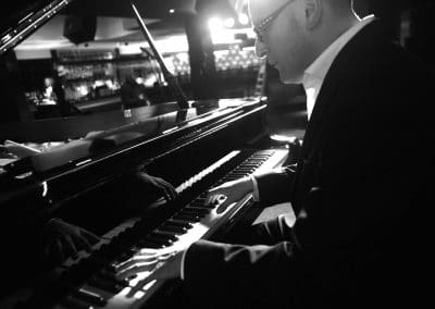 close up of wedding jazz pianist playing piano